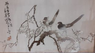 A pair of Vintage Chinese silk embroideries with birds, signed, framed and glazed, (43x68.5 cm). (