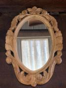 A small carved wooden framed mirror (46cm x 30cm)