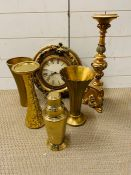 Six gold coloured decorative objects including a clock.