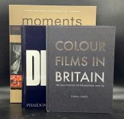 A collection of four large reference books on film and photography