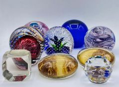 A selection of nine assorted glass paperweights