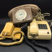 A Vintage Siemens push button phone and two other vintage phones.