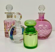 A selection of four perfume bottles