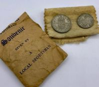 A Queen Elizabeth II Coronation commemorative shilling and sixpence in original packet.