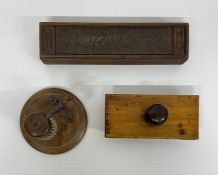 A selection of three antique desk items to include a blotter, inkwell and pencil case.