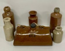 A selection of five stoneware bottles and a stoneware Bed warmer