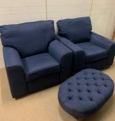 Two blue armchairs, one of which is a recliner and one with footstool