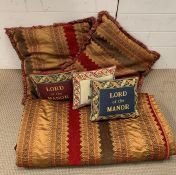 An American quilt with matching cushions and three needlework cushions