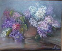 'Vase with hydrangeas', an oil on canvas signed 'Mcartney' within an elaborate frame, (39x50 cm).