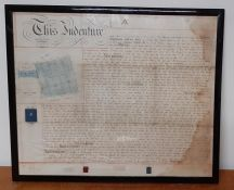 An antique English Indenture document, with seals.