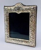 A small silver photo frame, by Kitney & Co, hallmarked London 2007 (12cm x 9.5cm)