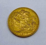 A 1900 Gold Sovereign coin.