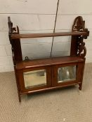A mahogany wall unit with mirrored doors to front (H74cm W56cm)