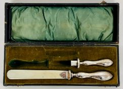 An ivory page turner with silver handle by HJC & Co Ltd along with silver handle.