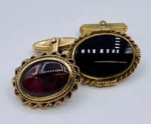 Two 9ct gold and semi precious stone Gents cuff links (9.1g Total weight)