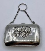 A silver Ladies purse with angel design embossed by C E Williams, hallmarked Birmingham 1905 (8cm