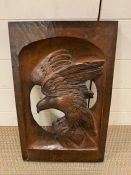 Folk art oak wall plaque carved to centre of an eagle (51cm x 32cm)