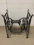 A Frister and Rossman sewing machine stand