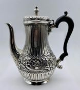 A silver coffee pot, total weight 549g, possibly by Harry Brasted and hallmarked for London 1899.