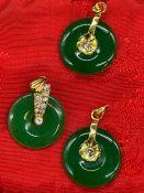 Three 18ct gold and Jade pendants