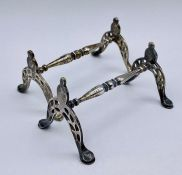A Pair of silver knife rests , hallmarked for London 1894 by Wakely & Wheeler