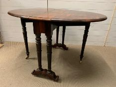 A Victorian Sutherland table, the oval top with drop sides (H74cm W120cm D88cm)
