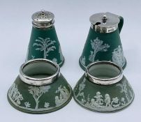 Four Wedgwood silver rimmed and topped cruets.