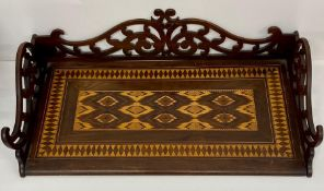 A 19th century rosewood and parquetry folding writing surface or book rack with pierced scroll