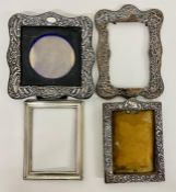 A selection of silver photo frames in various states of repair
