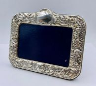 A silver picture frame, hallmarked for Sheffield 1997 by (14 cm x 17cm) by Carr's of Sheffield Ltd