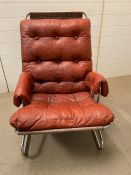 A Mid Century chrome tubular frame chair with leather button back seat