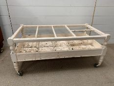 A vintage painted low drinks trolley with separate compartments (H40cm W93cm D49cm)