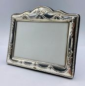 A silver photo frame, hallmarked for Birmingham, marked 958, by Ray Hall (13.5cm x 16cm)