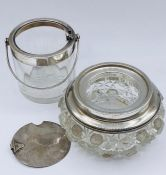 Two silver topped glass items, hallmarked