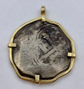 An Antique coin in 14ct gold mount.