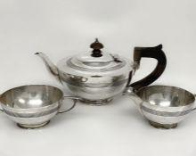 An Elkington & Co Art Deco silver tea set hallmarked for 1919, with teapot, sugar bowl and milk