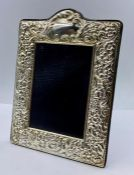 A silver photo frame with easel back by P J Panton, hallmarked for Edinburgh 2011 (22cm x 16cm)