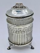A glass marmalade jar in silver holder on three feet and with silver lid, hallmarked for London,