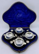 A Boxed set of four silver salts along with spoons, Birmingham 1900 by Hilliard & Thomason