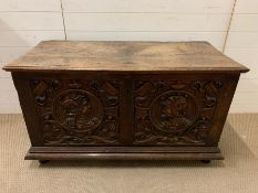 A late 16th century/early 17th century French or Spanish walnut coffer, the two plank rising lid