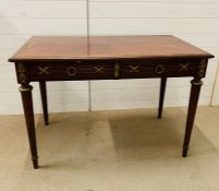 An Empire style library table, raised on reeded tapered legs and metal work to sides (H75cm W110cm