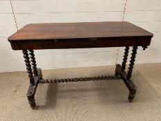 A mahogany side table on barley twist kegs and stretcher (H68cm W99cm D50cm)
