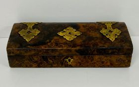 A burr effect wooden box, with brass detailing AF
