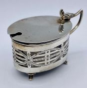 A Chester hallmarked silver salt with blue glass liner