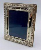 A silver photo frame by Carr's of Sheffield Ltd, Hallmarked for Sheffield 1998. (13cm x 10cm)