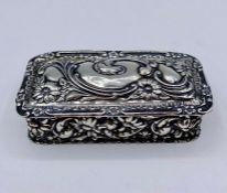 A small silver repoussé lidded pot (8cm x 4cm)