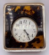 A Charles & Richard Comyns silver and tortoiseshell oversized travel watch and stand AF (11cm x