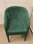 A green Lloyd Loom Chair