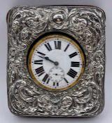 A Travel watch on silver easel frame by Henry Clifford Davis, hallmarked Birmingham 1907. (11cm x