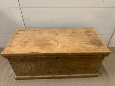 A pine trunk with metal handles to side (H40cm W92cm D47cm)
